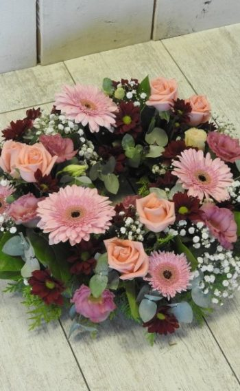 funeral flowers wreath pinks