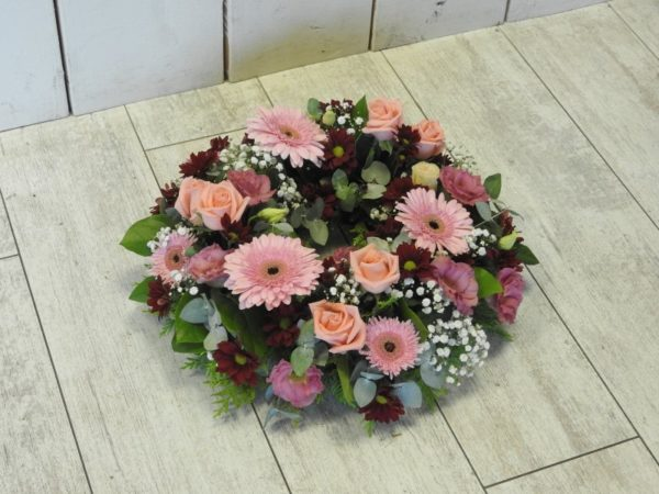 funeral flowers wreath pinks