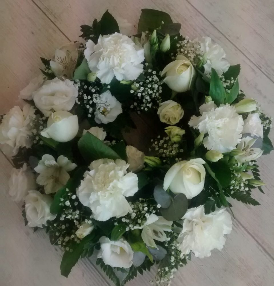 Funeral flowers wreath white wexford town flowers onlinelilybloom funeral flowers wreath white izmirmasajfo